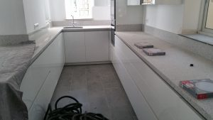 Builders installing a new kitchen in Malaga
