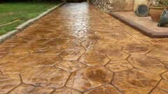 Builders working with stamped concrete