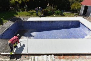 Installing new pool surround, Marbella